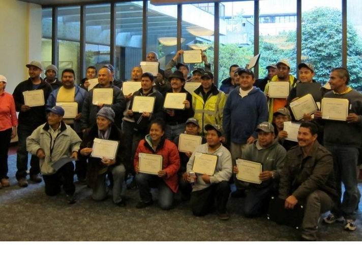 Participants in Plant Amnesty's  Spanish language pruning class, funded through a Community Forestry Assistance Grant, show their certificates of completion. Photo: Plant Amnesty.